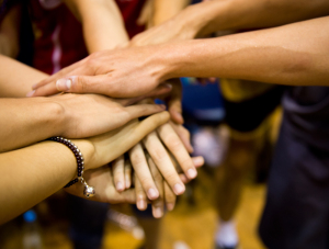 Mutual support shown by friends with their hands together